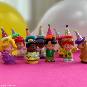 Little People Toys wearing party hats