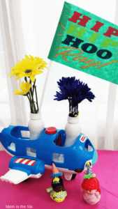 Little People Airplane with flowers and a banner to make a center piece