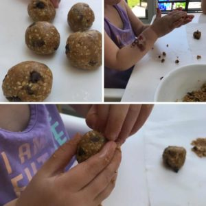 toddler hands rolling up balls of cookie dough