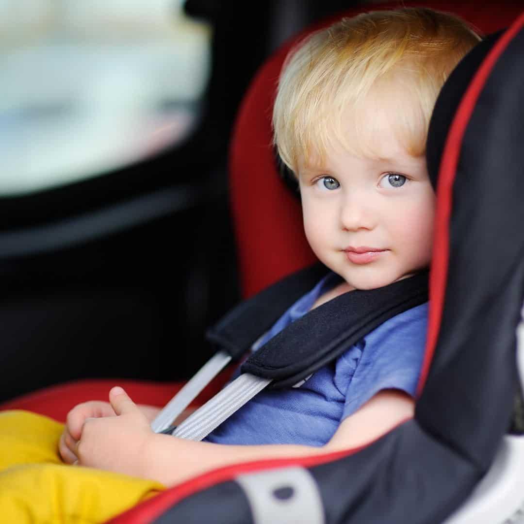 toddler sitting in a car seat