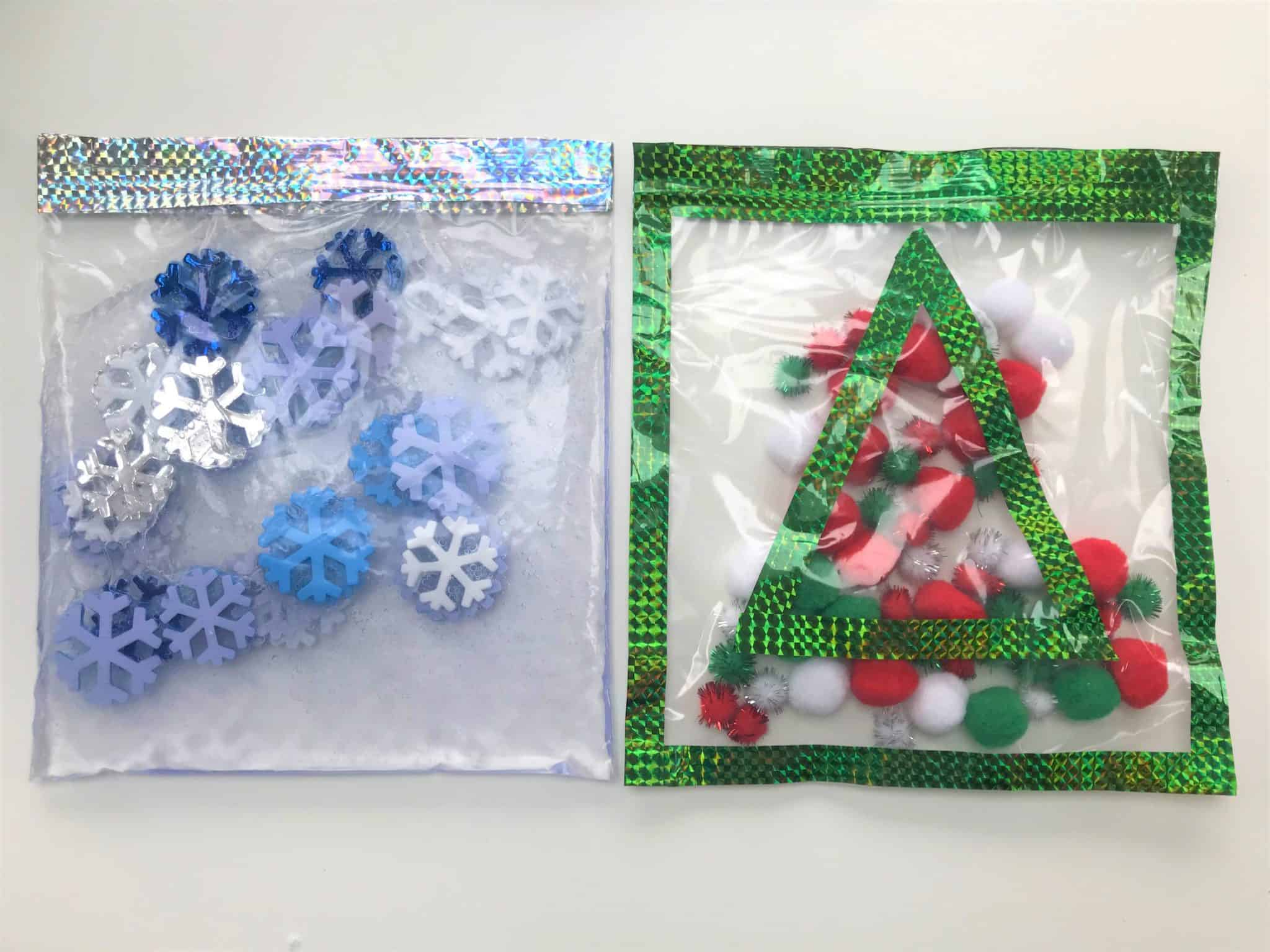 Two holiday themed sensory bags. Left contains blue and white snowflakes. The right features a christmas tree with pom poms